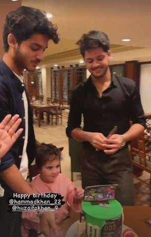 Aiman and Minal celebrate their twin brother's birthday