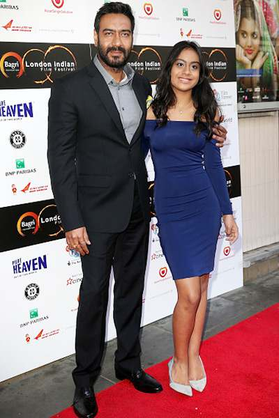 Photo: Ajay Devgan snapped with wife Kajol and daughter